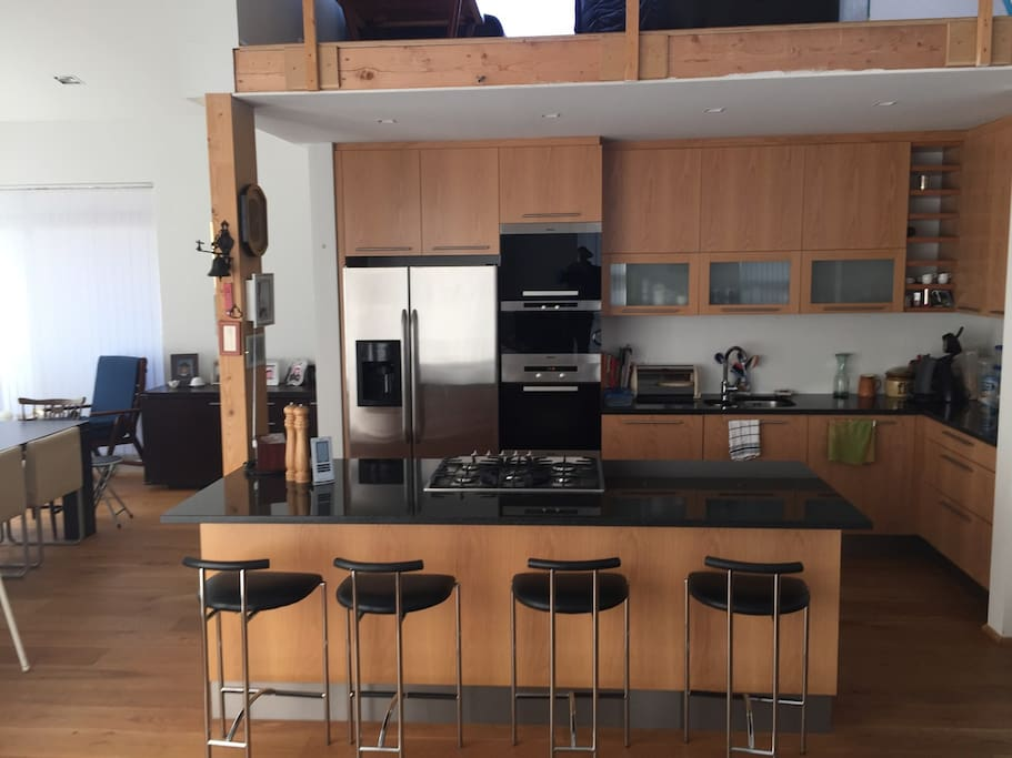 Well equipped modern kitchen. Gas stove, baking oven,  steam oven and dish washing machine, all from Miele. Double fridge w/ ice machine. Kitchen Island with granit tabletop.