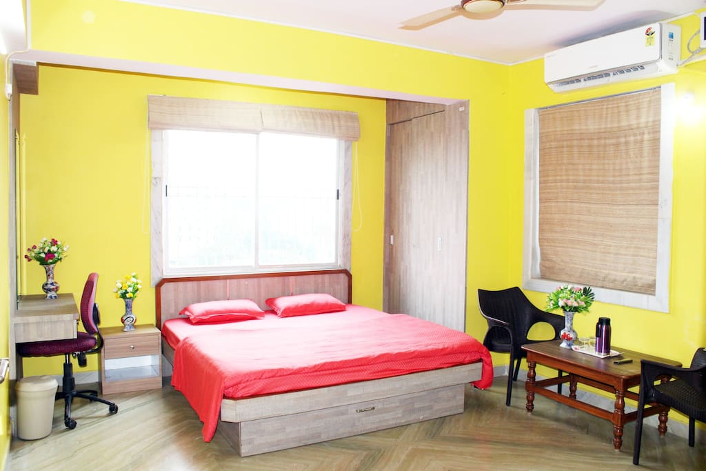 Room with King size Bed with Mattress Protector, Bedsheet, Comforter & Pillows alongwith Dressing cum Study Table, Chairs, Centre & Side Table, Wardrobes, Night-lamp and Black-out Curtains.
