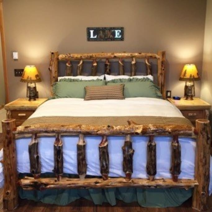 Sleep well on a King sized, pillow top mattress and custom made log bed