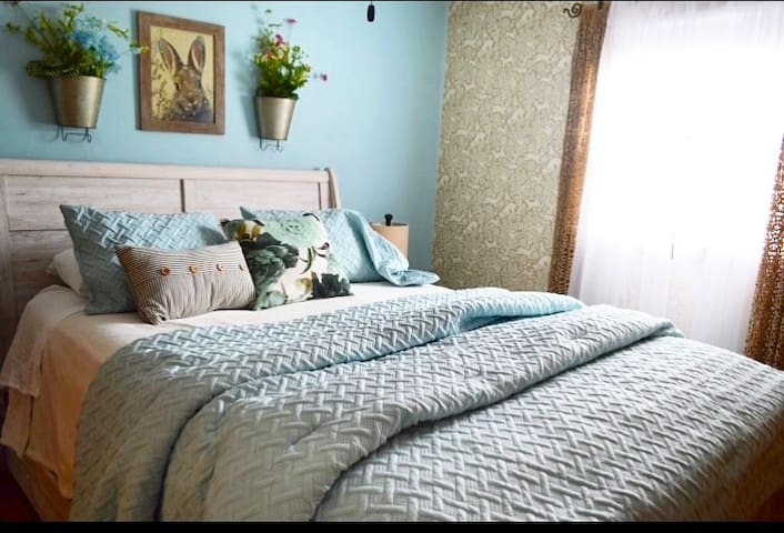 Bedroom #1- queen size bed in whimsical forest theme. Full closet & vanity area.  Very comfortable sleigh bed.