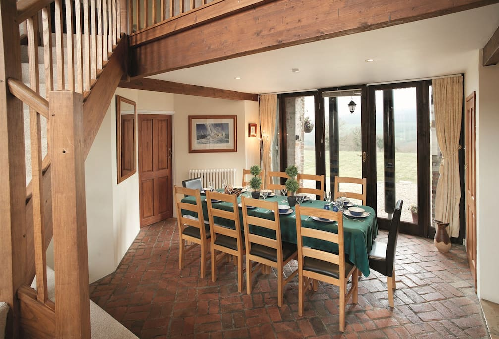 Ground floor: Dining room with views across the Dorset countryside and staircase leading to the first floor sitting room
