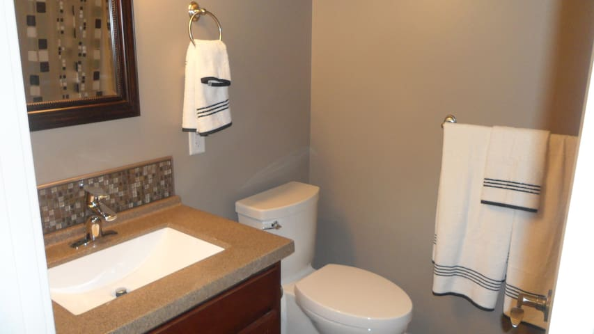 Private Bathroom off bedroom with soaker tub and heated tile floor
