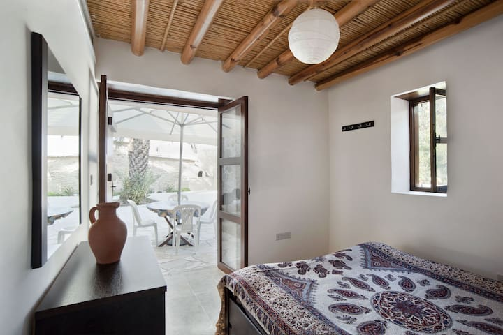 Bedroom with Garden view and bamboo ceiling