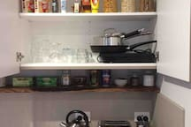 Kitchenette appliances include toaster, kettle, Nespresso coffee machine with frother, single induction cooktop, 2 x pots and a pan, rice cooker and  basic condiments.