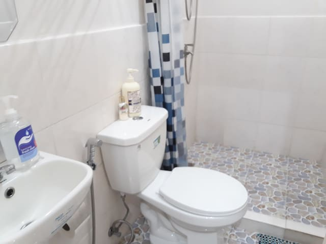 Private toilet and bath inside the room.