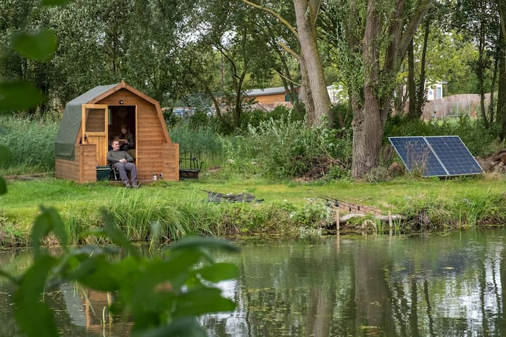 Wooden glamping pod (double or twin) on the banks of our specimen carp fishing lake.