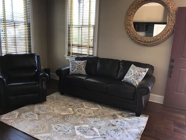 """Living area includes a 55"""" 4K Samsung TV with Sound bar and blue tooth adapter.  Half bath is located near by."""