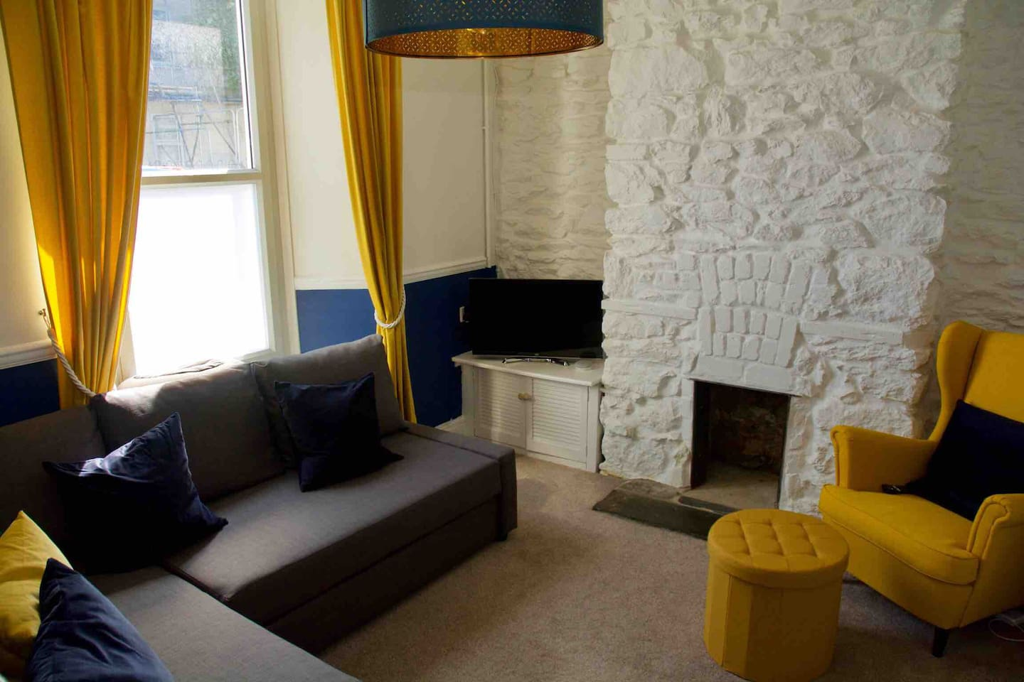 Our cosy lounge with fantastic original stone feature wall. 32inch HD TV with Netflix.