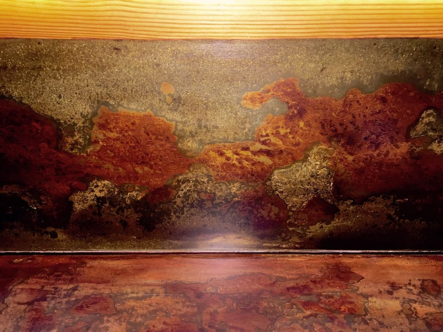 That galvanized countertop was distressed and sealed as the zink washed away and the exposed mild steel oxidized. We used multiple (like 9+) coats of finish to capture the zink and iron oxide mid reaction.