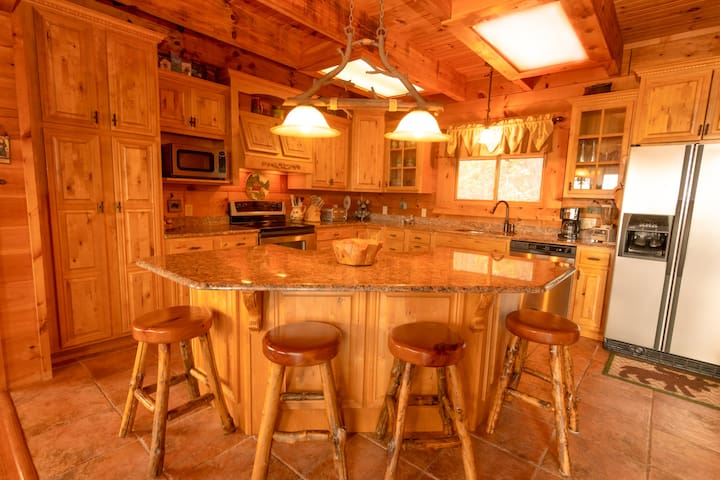 Fully appointed kitchen with everything you need for meal preparation and serving, unless you prefer one of the many nearby restaurants!  Four-seat island in kitchen is in addition to large dining room table.
