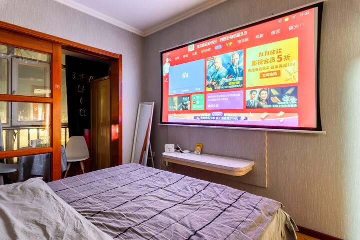 易佳公寓巨幕投影,1.8米舒适大床房,中央大街,冰雪大世界,太阳岛,卓展购物中心,可做饭