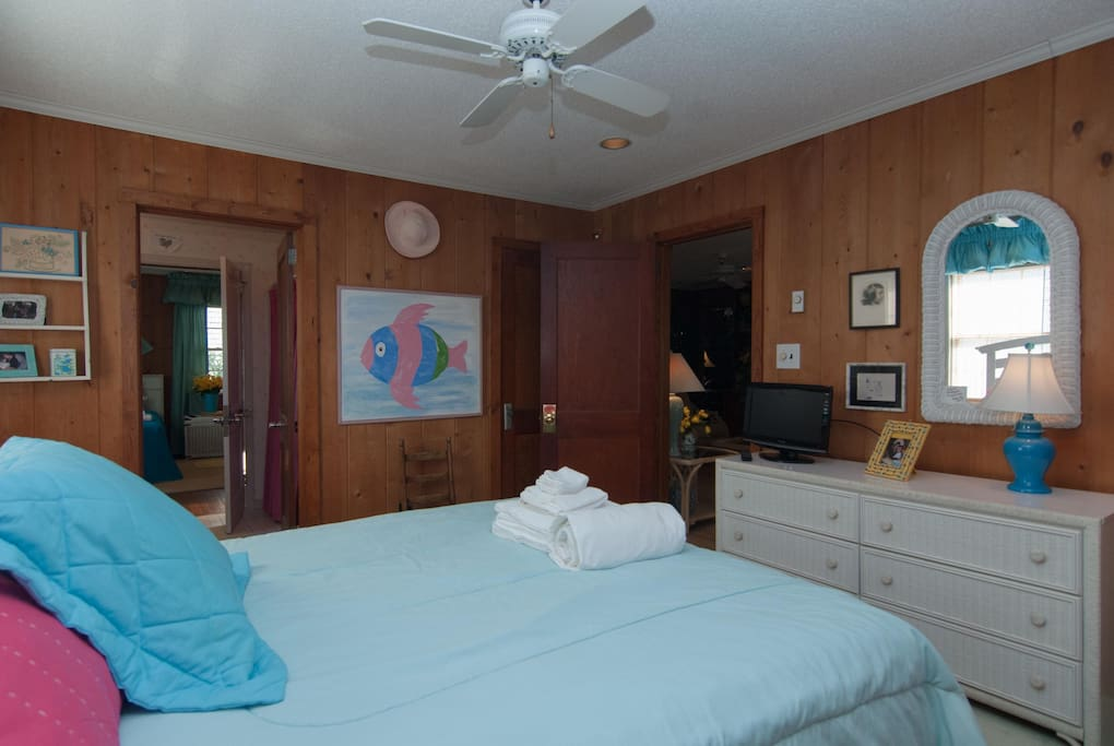 2nd bedroom with queen bed and shared bathroom.
