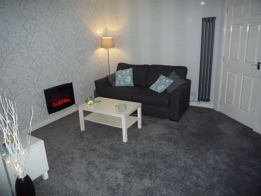 Lounge (additional view) with modern Contemporary Radiator + 3 seater Sofa