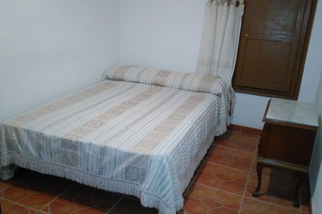 Guest double bedroom with wardrobe. Located on the lower floor.