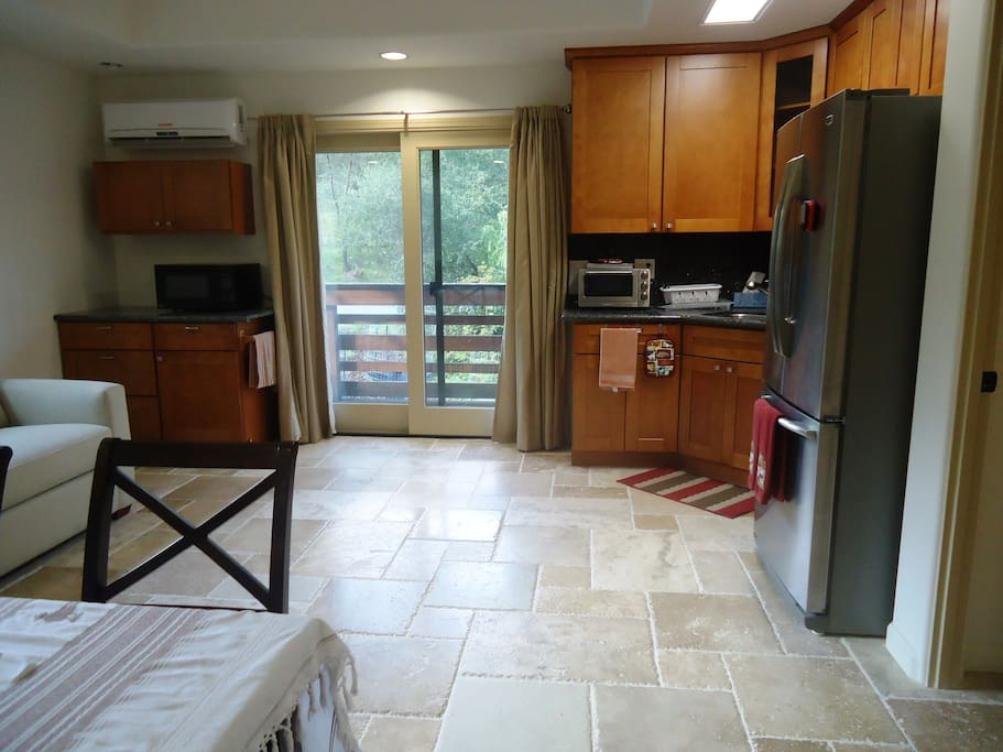 Living area has a complete kitchen with stove.