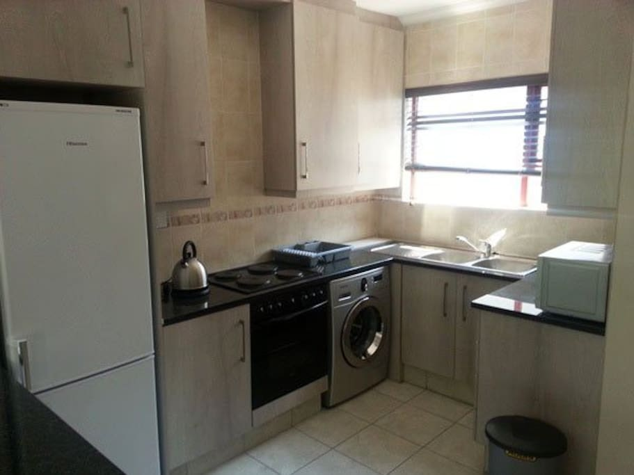 Ktchenette with oven, washing m/c fridge, microwave.