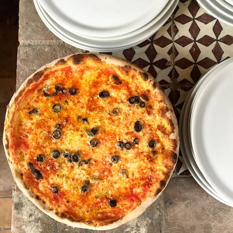 Pizzas are cooked in front of the guests based on their  requests.