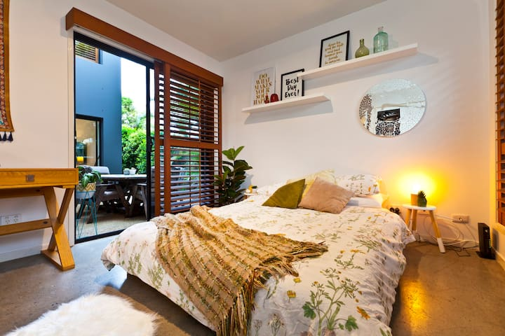 Downstairs Queen bedroom opens out to alfresco dining