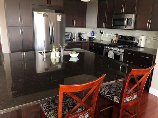 Gourmet kitchen - granite island, stainless appliances, dishwasher