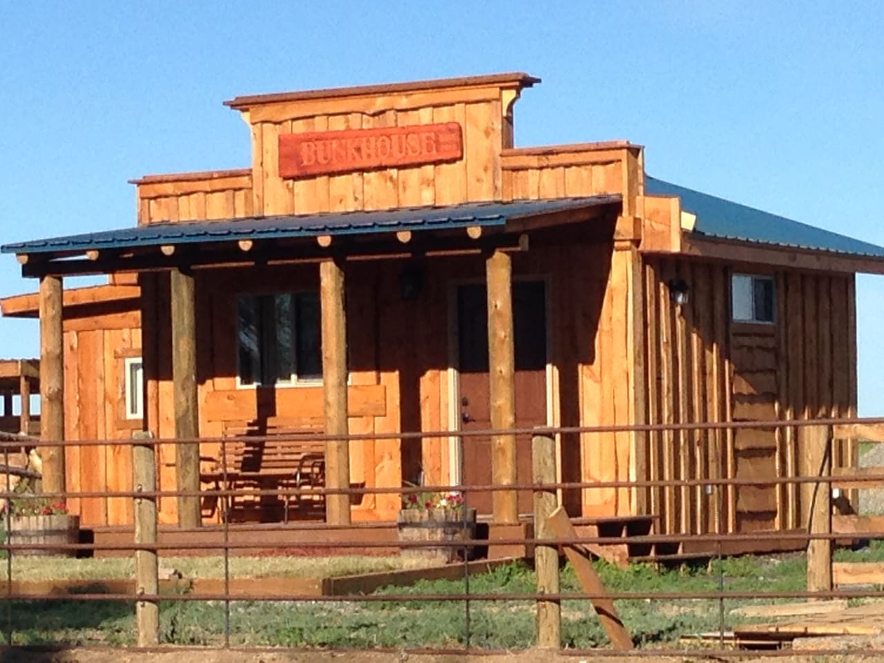The Bunkhouse is built in the style of the old west. You will find all the comforts of home, including TV, WiFi, DVD player , A/C and views beyond description. Your own cabin with a complete private bathroom. No neighbors except the horses!
