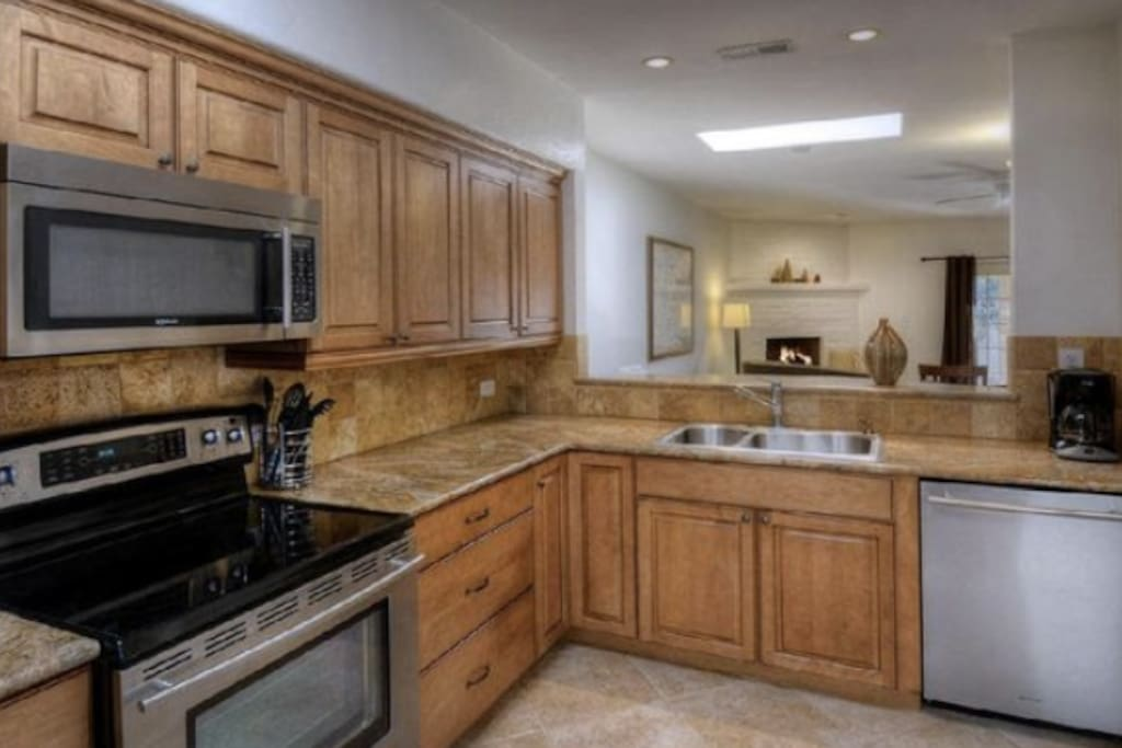 Custom kitchen with granite countertops and Jenn Air Appliances