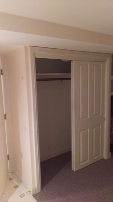 Closet adjacent to door entering kitchen/living space