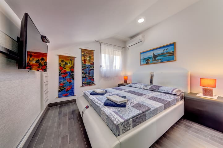 There is one king-size bed available, with night stands and place to put away your clothes.