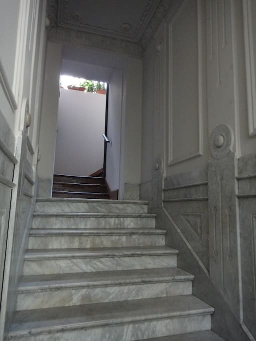 Entrance with marble staircase