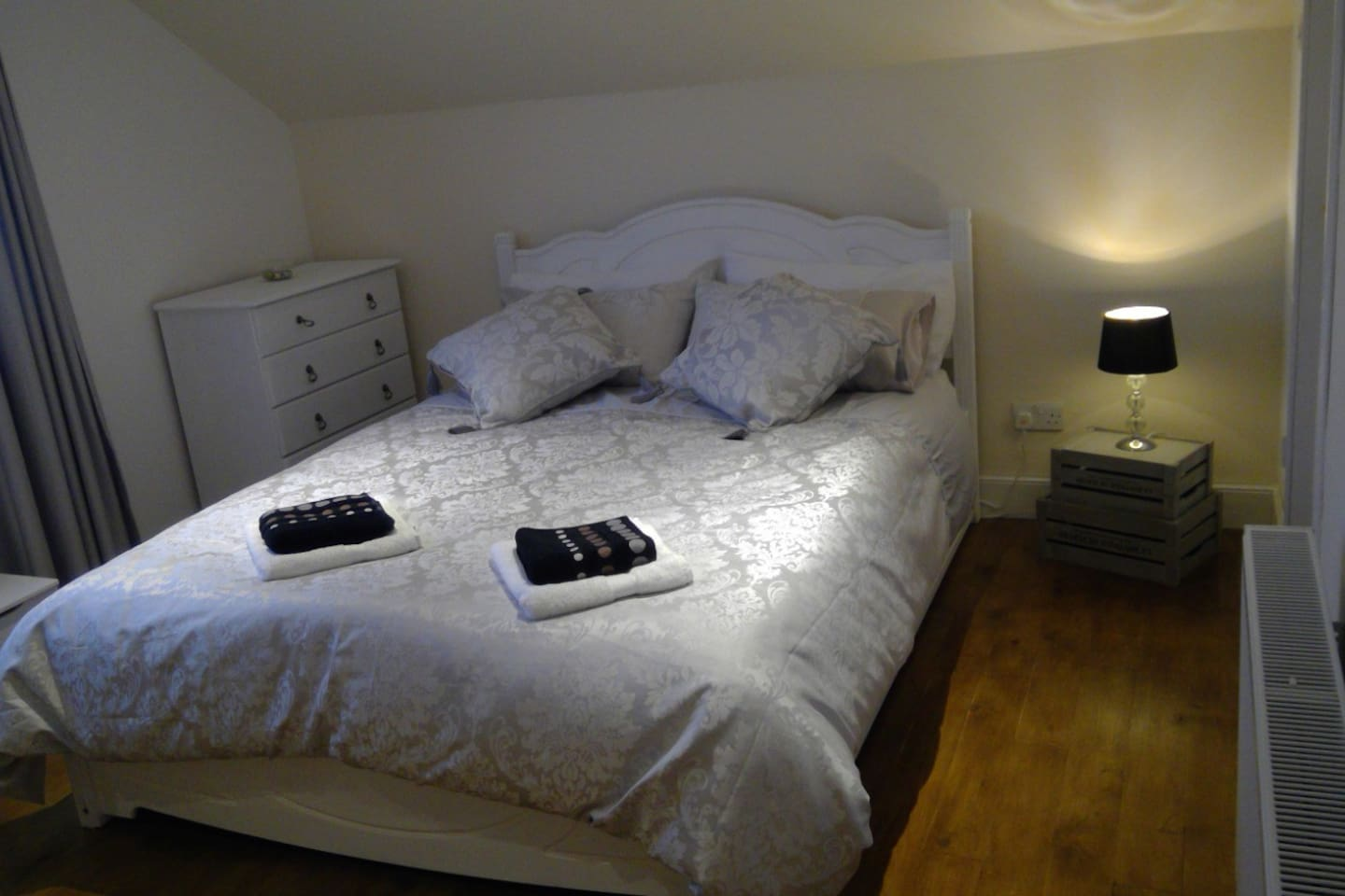 Bedroom one with double bed and en suite.