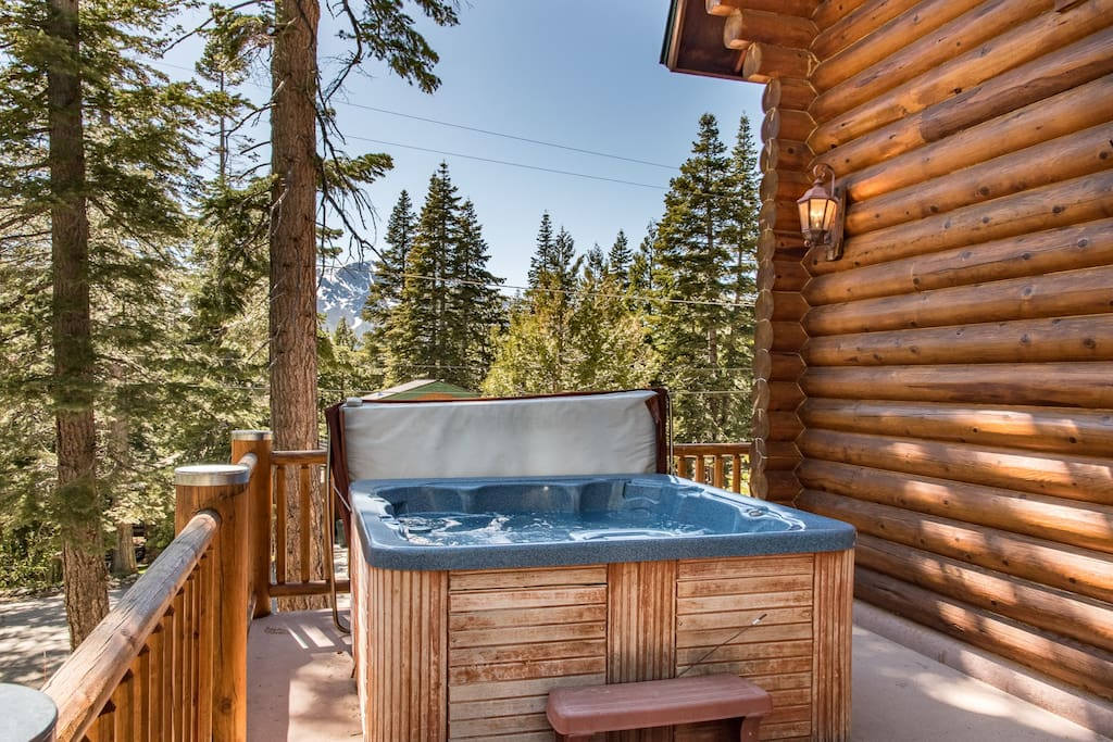 Soak in the hot tub on the deck with mountain views through the pines.
