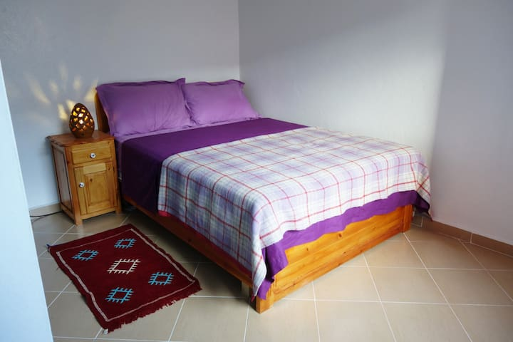 Bedroom for 2 with double bed 140x190, high-quality mattress, hand crafted bedside table and lamp and spacious built-in wardrobe