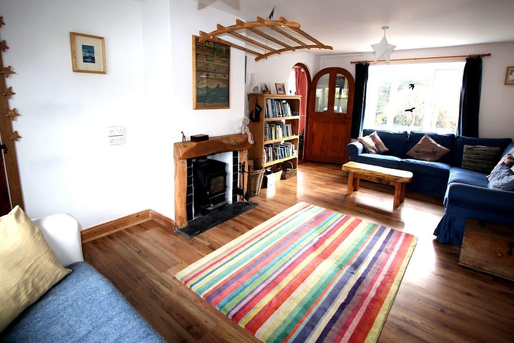 Living room with log burner.