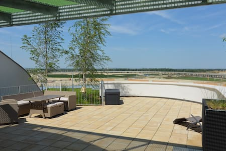 Green Living Apartment VI mit Terrasse & Seeblick