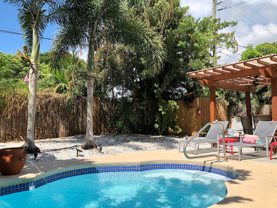 Welcome to The Oasis! Lounge poolside in the private pool area and soak up the warm Florida sun! Tall palm trees and lush greenery in the backyard give The Oasis its name. Pool/beach towels provided for a fuss-free vacation.