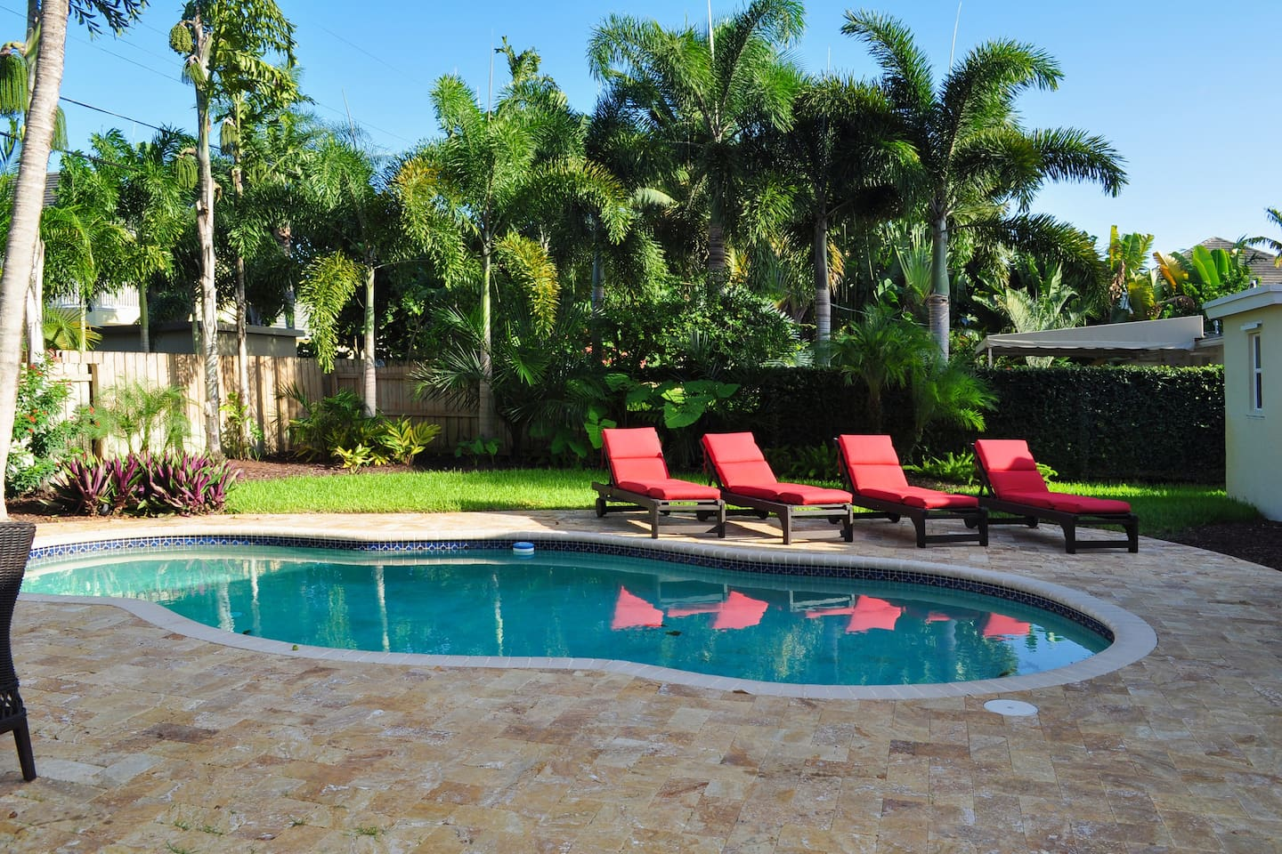 Enjoy a heated pool surrounded by lush landscaping.