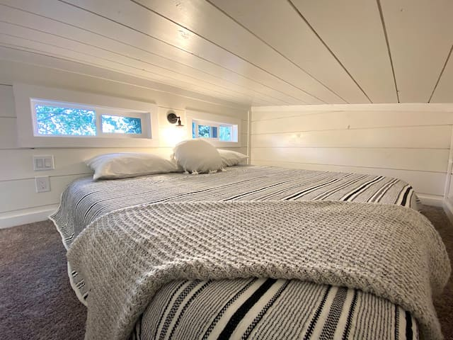 On the other end of the home above the kitchen is the King bed loft. Even with a king size bed there is plenty of room!