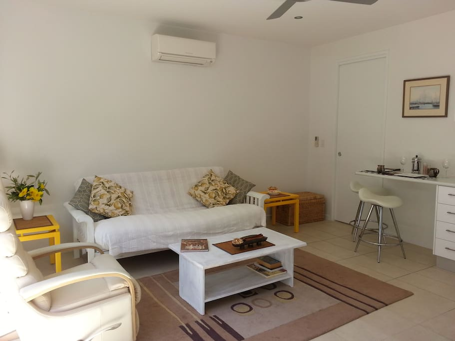 Living Room with aircon and fan,