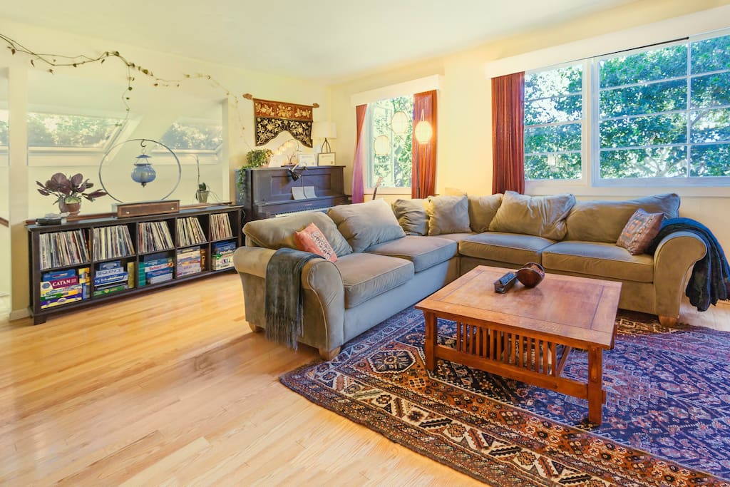 Large, light-filled comfortable living room with fireplace.  TV, DVD Player, stream Netflix, stereo and piano.