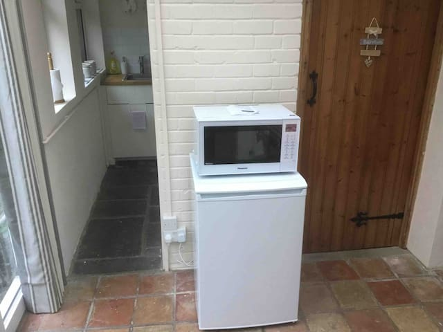 Combination microwave and oven. Fridge with small freezer compartment.