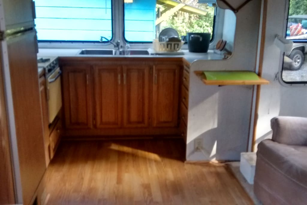 Kitchen with gas stove, Swedish refrigerator and microwave.  Bright and roomy.