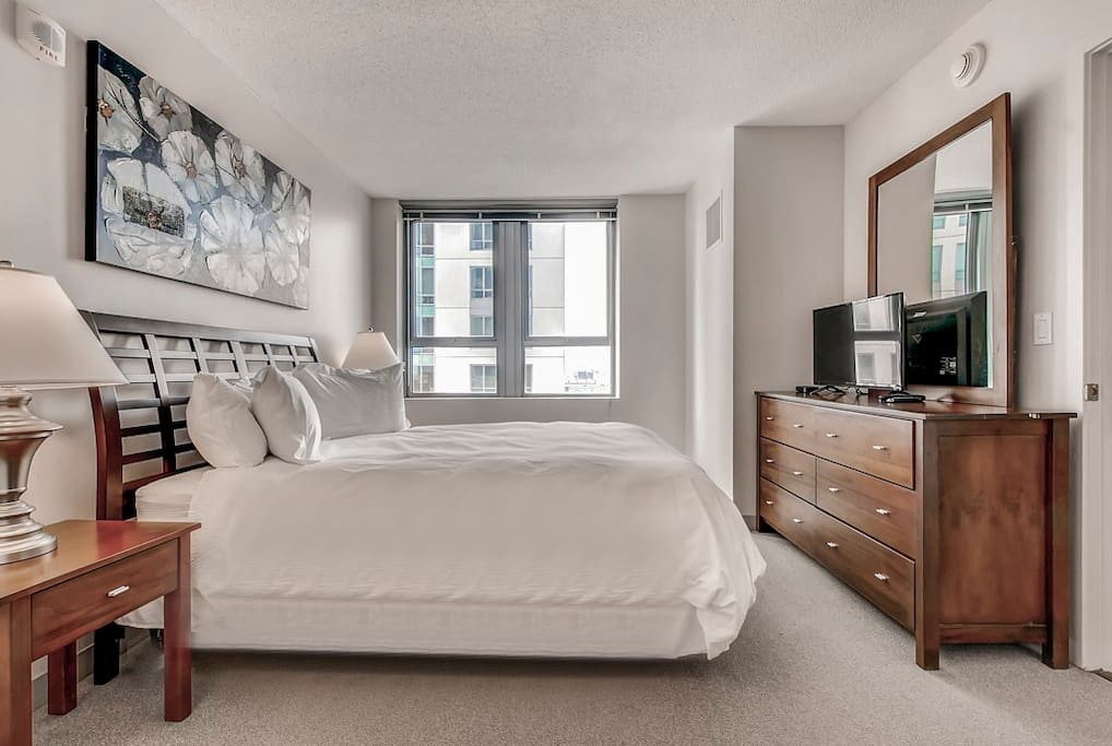 The private bedroom offers a queen bed with ample closet space.