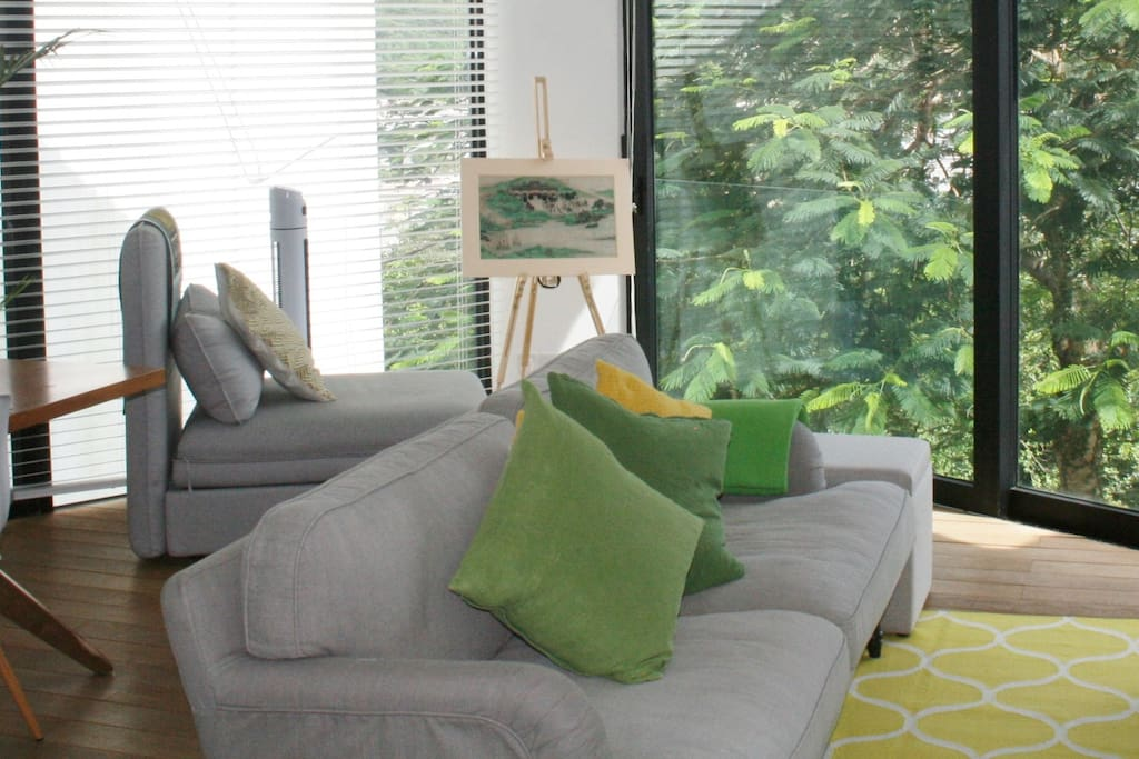 Bright living room with green views