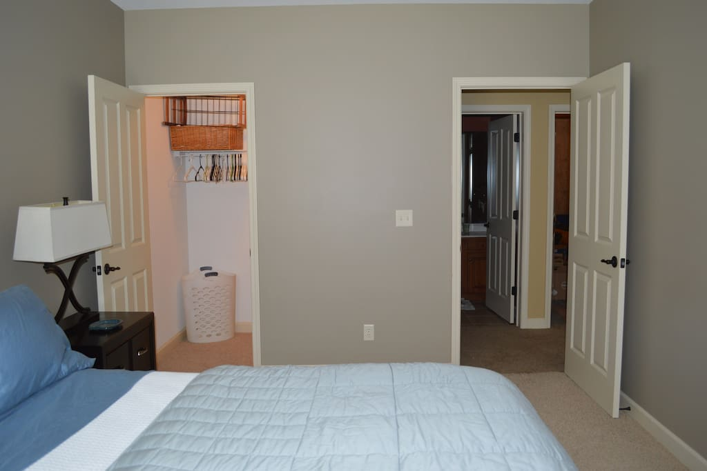 Shows deep closet and entrance to bathroom dedicate to this guest room