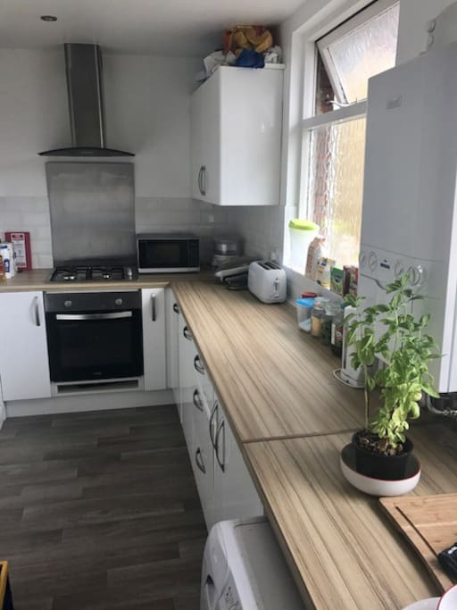 New kitchen with all modern appliances and a large fridge