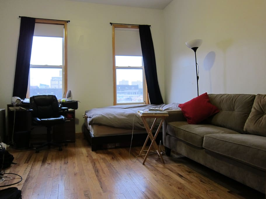 High ceilings, with room for a full size bed, desk, and a couch!
