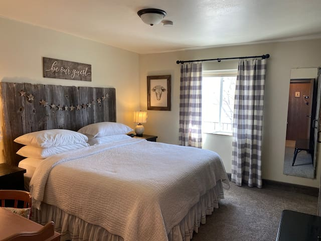 King bed with private bathroom. Room #2 at the Circle View Guest Ranch.