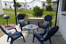 Outside sitting area with a new misting system to help keep you cool.
