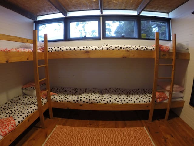 Six bunks, shot with a wide angle so you can see them all