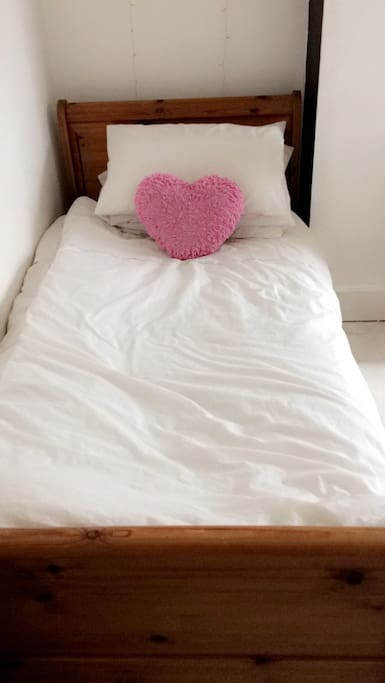 Single bed in triple room.