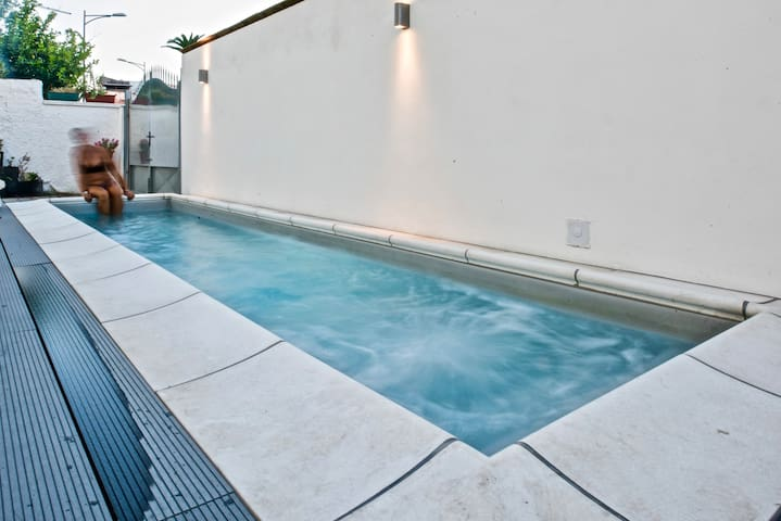 Relax by pool at Boutique Loft